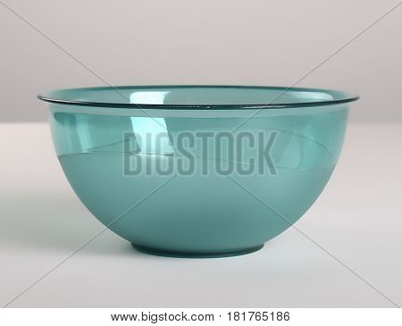 Green transparent plastic deep dish on the table