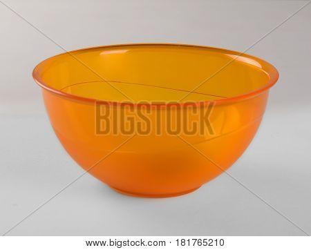Orange transparent plastic deep dish isolated on white background