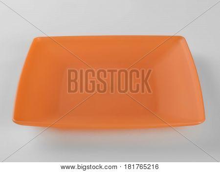 Orange plastic shallow dish food on the table