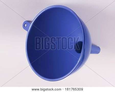 Blue plastic kitchen funnel liquid on the table, top view