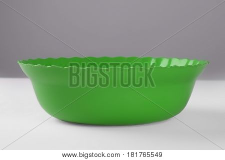 Green round plastic deep dish. front view