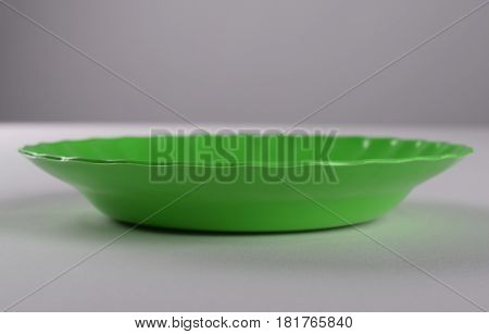 Green plastic shallow dish food in the kitchen