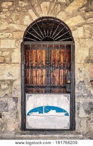 Door at San Juan de Gaztelugatxe is church dedicated to John the Baptis connected to the mainland by a man-made bridge, Bermeo, Basque Country,Spain.