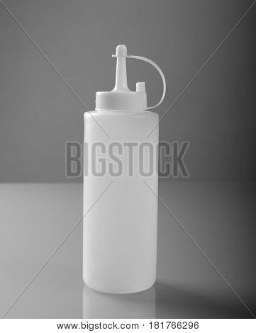 White plastic sos bottle with cap front view