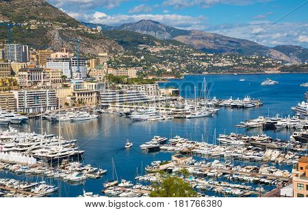 Monaco, Monte Carlo - September 16, 2016: Principality of Monaco. View of the seaport and the city of Monte Carlo with luxury yachts and sail boats