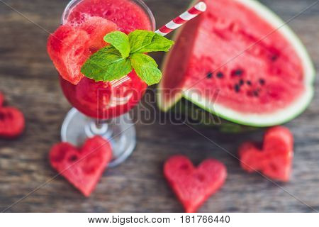 Healthy Watermelon Smoothie With Mint, A Piece Of Watermelon, Hearts And A Striped Straw On A Wood B
