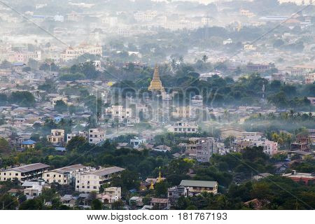 Mandalay with lake mountains, temples and pagodas seen from mandalay hill at sunset, Burma.