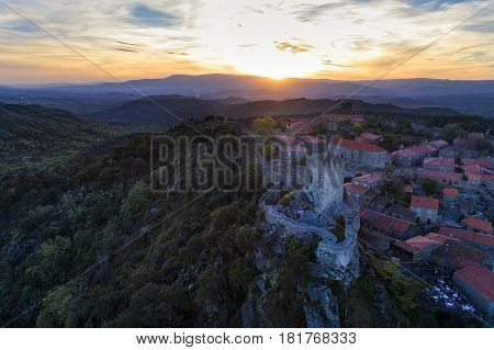 Aerial view of the Sortelha Village and Castle in Portugal at sunset; Concept for travel in Portugal