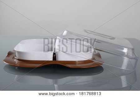 Shallow plastic bowl with lid and four compartments