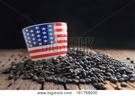 Close up shot of america flag pattern ceramic cup on pile of dark roasted coffee bean and wooden floor with copy space select focus on cup shallow depth of field