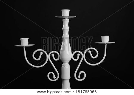Detail of white vintage table candlestick front view