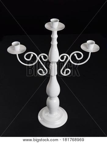 Vintage table candlestick on black background  top view
