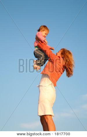 Mom Holds Child