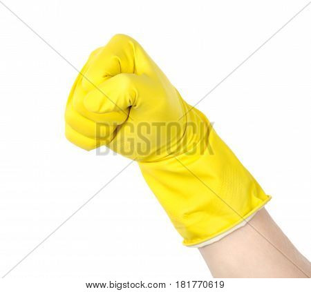 The fist in a yellow glove is isolated on a white background