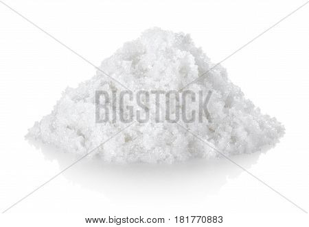 Heap of white processed granulated sugar, isolated on a white background.