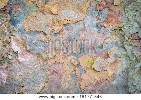background texture old brick wall with remnants of varicoloured plasters