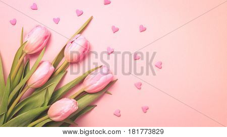 Pink Tulips With Pink Heart Sprinkles On The Pink Background. Flat Lay, Top View.  Valentines Backgr