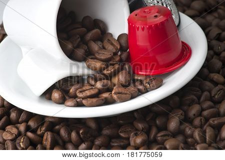 espresso capsules on the coffee beans background