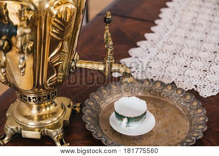 Ancient Russian samovar, a cup for tea on a vintage tray, traditional Russian tea drinking, copy space