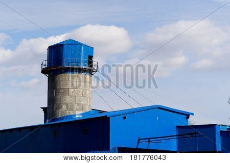 A water tower blue color in City.