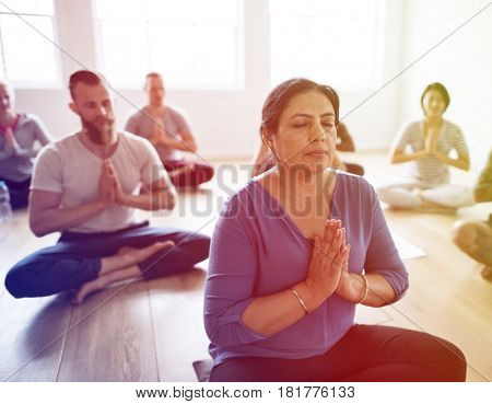 People are meditating sitting to practise