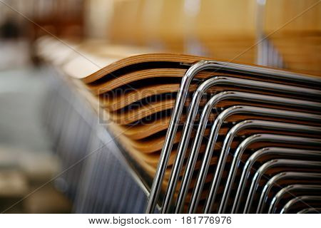 Wooden chairs with metal frame stacked neatly