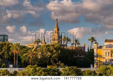 Giralda Spire Bell Tower of Seville Cathedral, Cathedral of Saint Mary of the See Church of El Salvador Seville, Andalusia Spain.The largest Gothic Cathedral in the World.