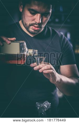 Barman Is Pouring Alcoholic Drink