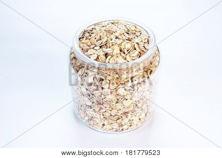 A jar with oats on white background isolated