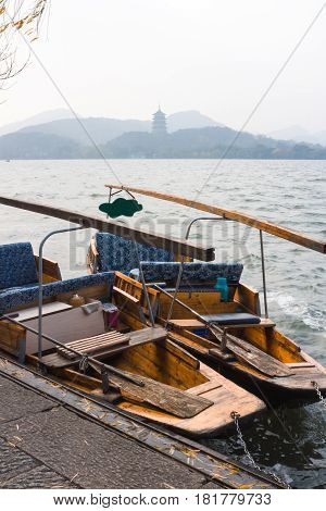 China landscape of boat on the lake with traditional building background.