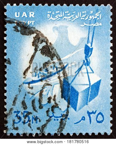EGYPT - CIRCA 1961: a stamp printed in Egypt shows Eagle Ship and Crate on Hoist circa 1961