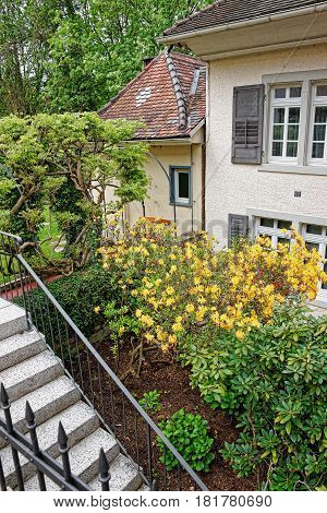 Baden-Baden Germany - April 30 2012: Inner yard with the small garden of a house in Baden-Baden Baden-Wurttemberg state of Germany