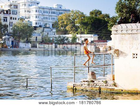 Udaipur, India - January 12, 2017:   Unidentified Young Boy Swimming In Pichola Lake