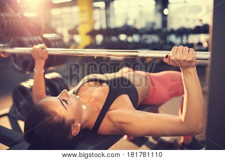 Woman training on bench press