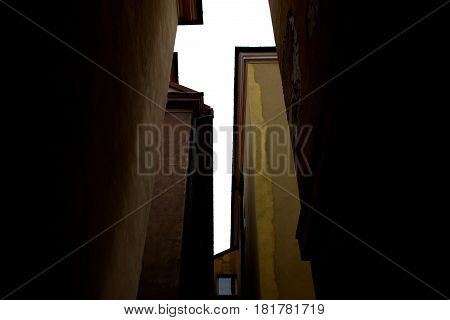 dialog among the high walls of houses in the Old Town in Warsaw