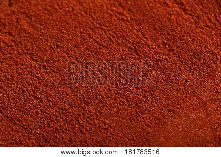 The Red paprika powder background, close up