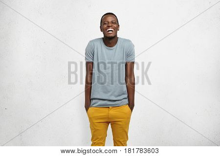 Human Feelings And Emotions. Body Language. Studio Shot Of Young Cheerful African Male, Dressed Casu