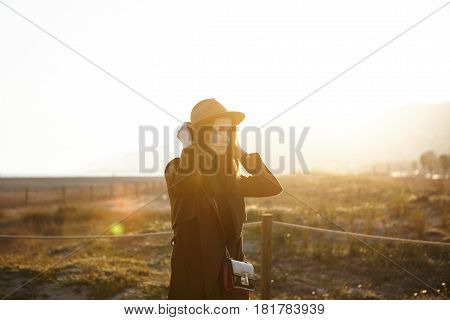 Confident Attractive Young Brunette Woman Student With Pretty Face Adjusting Her Hat During Morning