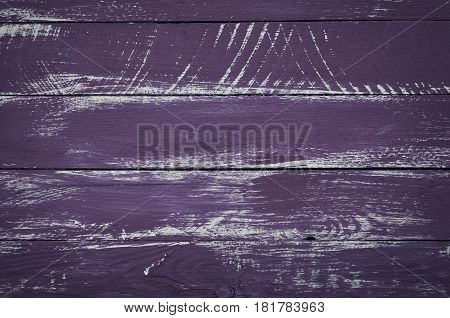 purple wooden background from the old boards vintage toning