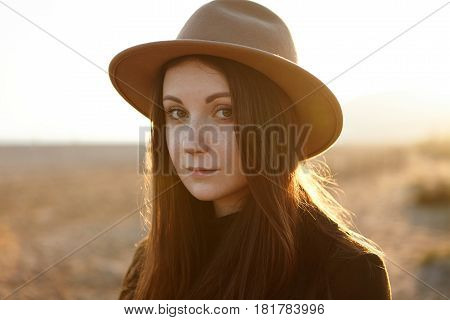 Outdoor Close Up Portrait Of Tender Young Romantic Woman With Magnetic Eyes, Wearing Hat, Looking At