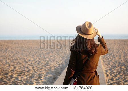 Side View Of Beautiful Female Stranger On Autumn Sand Beach. Brunette Woman Looking Into Distance, N