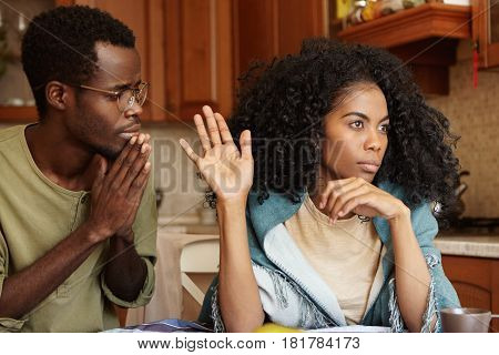 People, Relationships Problems And Divorce. Repentant Worried Dark-skinned Male Keeping Hands Presse