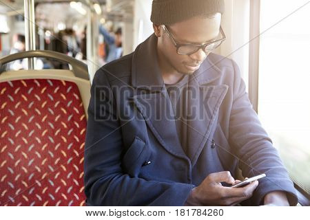 Transport, Tourism, Road Trip And People. Happy Cheerful Young Black Man In Trendy Clothing Sitting