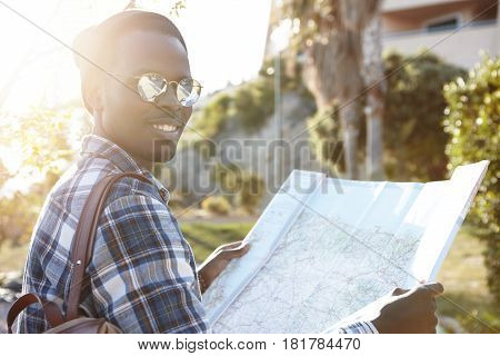 Attractive Stylish Afro American Tourist Looking At Camera With Happy Joyful Smile While Having Nice