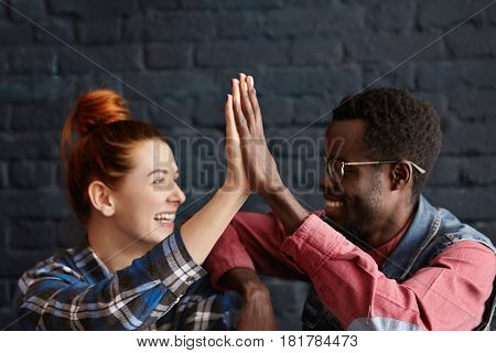 Happy Ginger White Student Girl And Her Handsome Black Male Group Mate In Eyeglasses Giving High Fiv