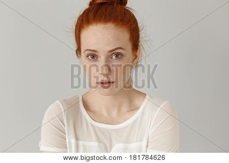 Headshot Of Attractive Young Woman Of Extraordinary Appearance Looking At Camera With Shy Subtle Smi