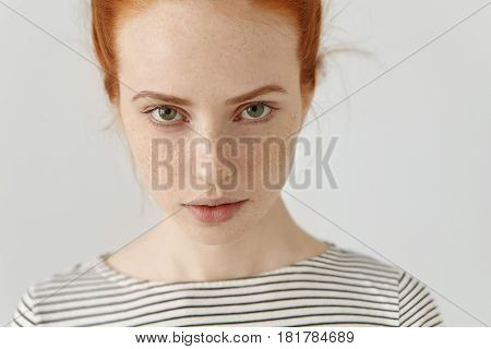 Human Face Expressions And Emotions. Portrait Of Young Redhead Woman In Sailor Shirt Having Confiden
