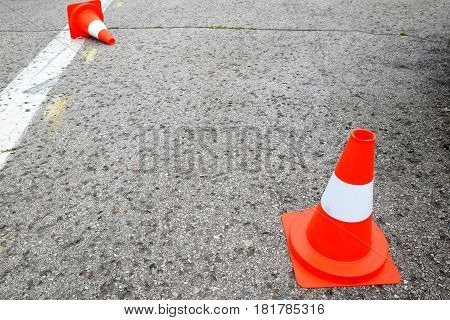white line on the asphalt and posts warning
