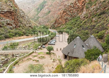 MEIRINGSPOORT SOUTH AFRICA - MARCH 23 2017: The parking area and information centre at the waterfall in the scenic Meiringpoort in the Western Cape Province of South Africa