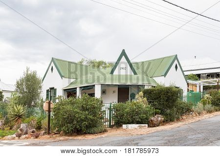 DE RUST SOUTH AFRICA - MARCH 23 2017: An historic old house built 1902 in De Rust a village in the Western Cape Province of South Africa